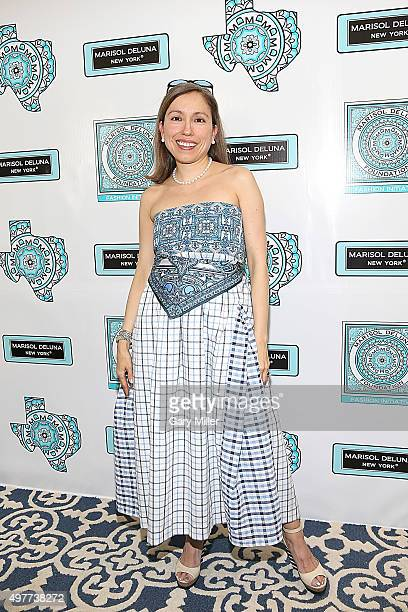 Fashion designer Marisol Deluna poses on the red carpet as Marisol Deluna New York Celebrates the Grand Opening Of Design Studio And Educational...