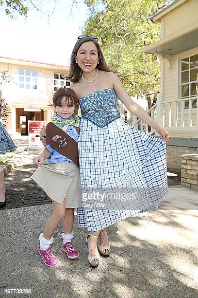 Fashion designer Marisol Deluna poses with a Girl Scout as Marisol Deluna New York Celebrates the Grand Opening Of Design Studio And Educational...