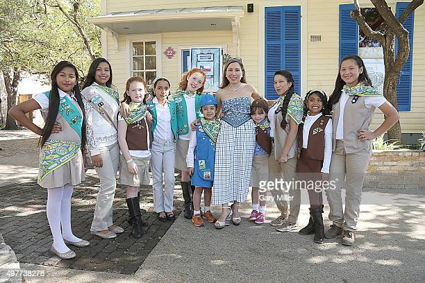 Fashion designer Marisol Deluna poses with Girl Scouts as Marisol Deluna New York Celebrates the Grand Opening Of Design Studio And Educational...