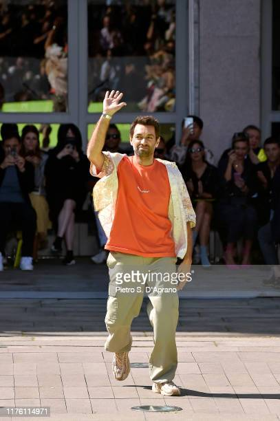 Fashion designer Massimo Giorgetti acknowledges the applause of the audience at the MSGM show during the Milan Fashion Week Spring/Summer 2020 on...