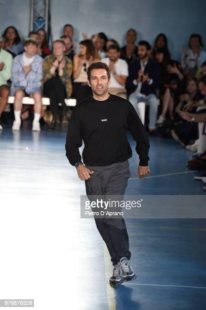 Fashion designer Massimo Giorgetti acknowledges the audience on the runway at the MSGM show during Milan Men's Fashion Week Spring/Summer 2019 on...