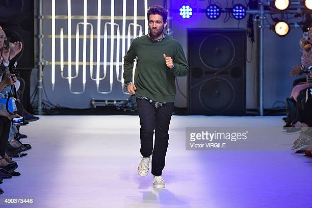 Fashion designer Massimo Giorgetti walks the runway during the MSGM fashion show as part of Milan Fashion Week Spring/Summer 2016 on September 27...