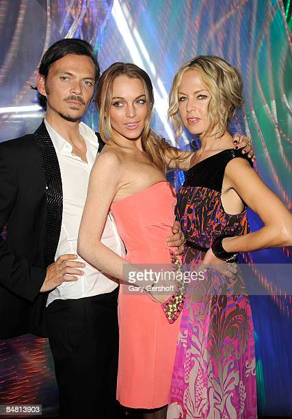 Fashion designer Matthew Williamson, actress Lindsay Lohan, and celebrity stylist, Rachel Zoe, attends the New York store opening celebration for...