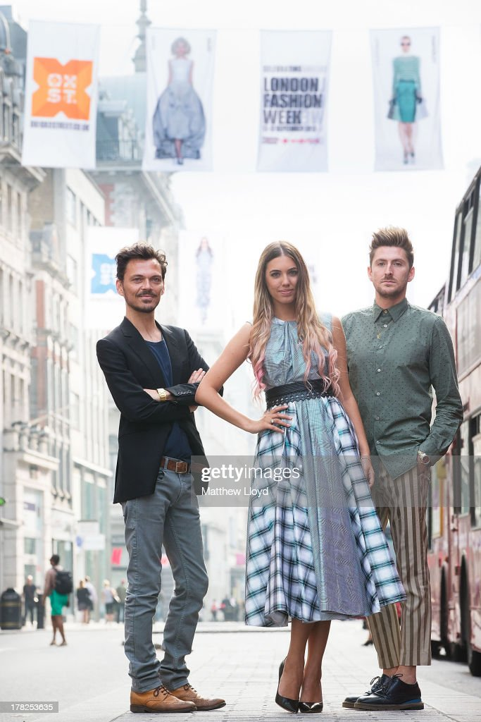Fashion designer Matthew Williamson, model Amber Le Bon, and designer Henry Holland pose for photographs as they unveil 75 fashion flags to launch OXFORD STREET FASHION SHOWCASE, in celebration of London Fashion Week on August 28, 2013 in London, England. The 12 foot high fashion flags, spanning over a mile of Oxford Street, feature A/W 13 catwalk shots from House of Holland, Matthew Williamson, Topshop Unique, Giles Deacon and Temperley London.