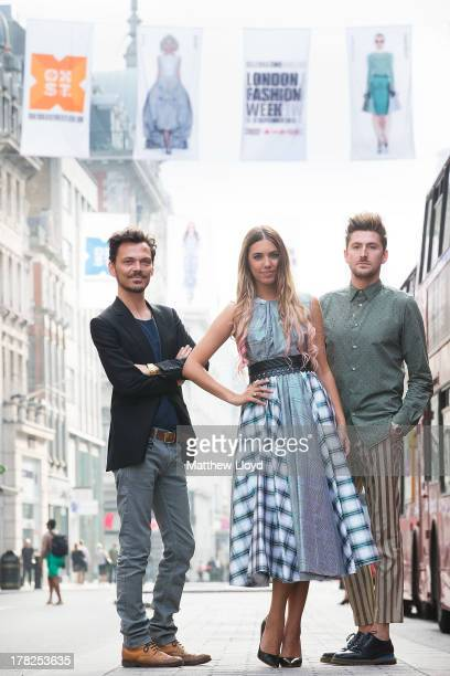 Fashion designer Matthew Williamson, model Amber Le Bon, and designer Henry Holland pose for photographs as they unveil 75 fashion flags to launch...