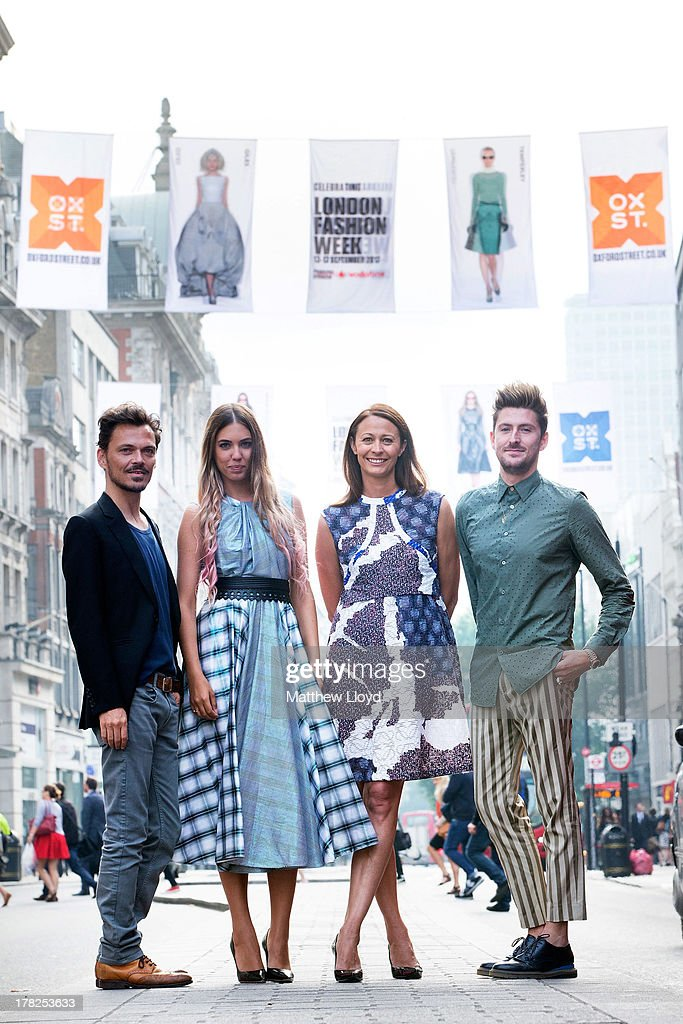 Fashion designer Matthew Williamson, model Amber Le Bon, CEO British Fashion Council Caroline Rush and designer Henry Holland pose for photographs as they unveil 75 fashion flags to launch OXFORD STREET FASHION SHOWCASE, in celebration of London Fashion Week on August 28, 2013 in London, England. The 12 foot high fashion flags, spanning over a mile of Oxford Street, feature A/W 13 catwalk shots from House of Holland, Matthew Williamson, Topshop Unique, Giles Deacon and Temperley London.