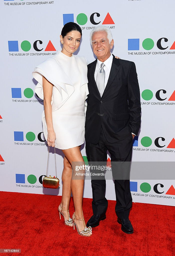 Fashion designer Maurice Marciano (R) and Cio Soler arrive at the 'Yesssss!' 2013 MOCA Gala, celebrating the opening of the exhibition Urs Fischer at MOCA Grand Avenue on April 20, 2013 in Los Angeles, California.