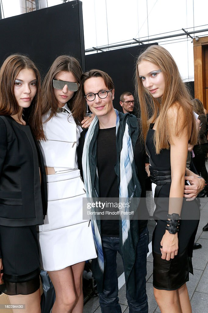 Fashion Designer Maxime Simoens with his models after his show as part of the Paris Fashion Week Womenswear Spring/Summer 2014, held at Orangerie du parc Andre Citroen on September 29, 2013 in Paris, France.