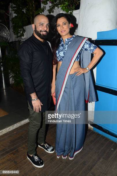 Fashion designer Mayyur Girotra with Bollywood actor Mini Mathur during the launch of fashion designer Mayur Girotra's exclusive pret line White...