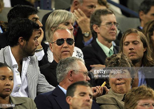 Fashion designer Michael Kors and Lance Le Pere Vice President of Michael Kors Women's Design watch the match between Amelie Mauresmo of France and...