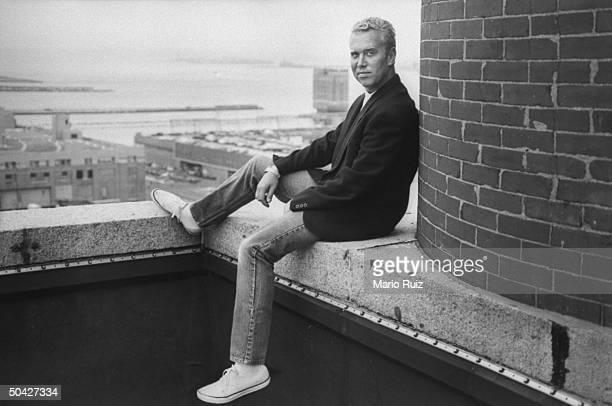 Fashion designer Michael Kors posing on the terrace of his penthouse