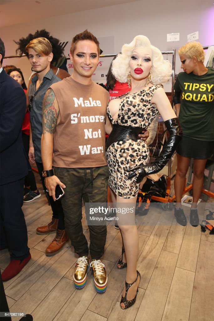 Fashion designer, Michael Kuluva and model Amanda Lepore, pose backstage at the Tumbler And Tipsy By Michael Kuluva fashion show during New York Fashion Week: Style360 at Metropolitan Pavilion on September 13, 2017 in New York City.