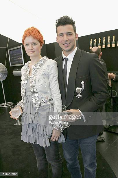 Fashion Designer Michelle Jank and Jason Capobianco attend the Melbourne Cup Carnival's Derby Day in the Moet et Chandon marquee at Flemington on...