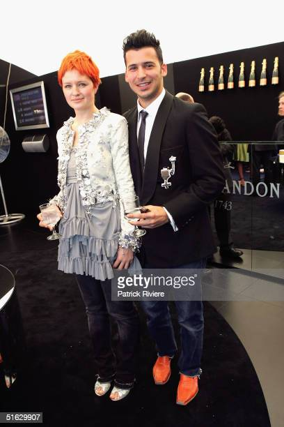 Fashion Designer Michelle Jank and Jason Capobianco attend the Melbourne Cup Carnival's Derby Day in the Moet et Chandon marquee at Flemington...