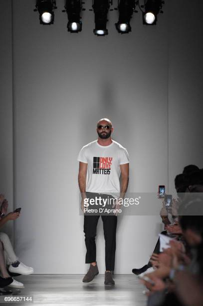 Fashion designer Milan Vukmirovic acknowledges the applause of the audience after the Ports 1961 show during Milan Men's Fashion Week Spring/Summer...