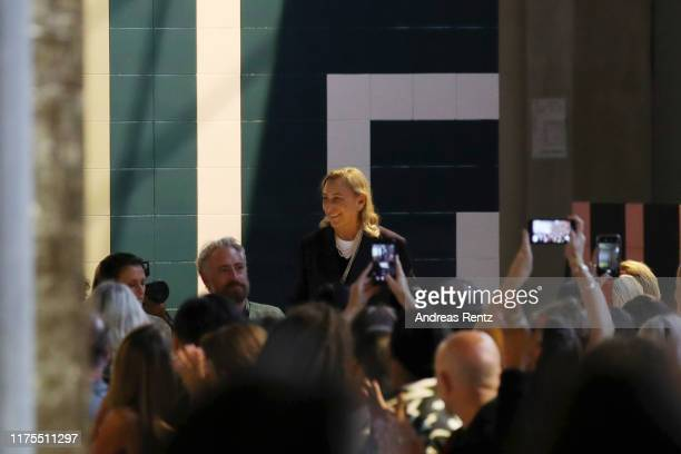 Fashion designer Miuccia Prada acknowledges the applause of the audience at the Prada show during the Milan Fashion Week Spring/Summer 2020 on...