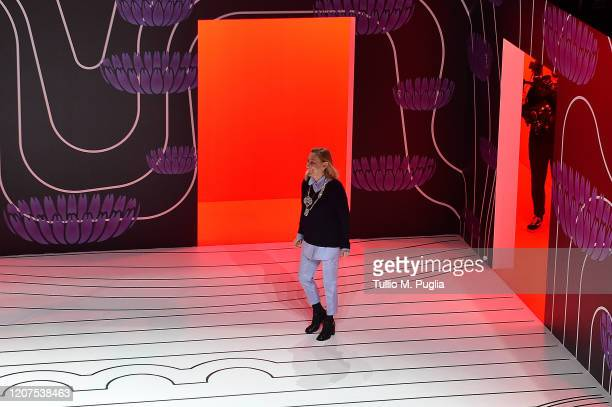 Fashion designer Miuccia Prada acknowledges the applause of the audience during the Prada fashion show as part of Milan Fashion Week Fall/Winter...