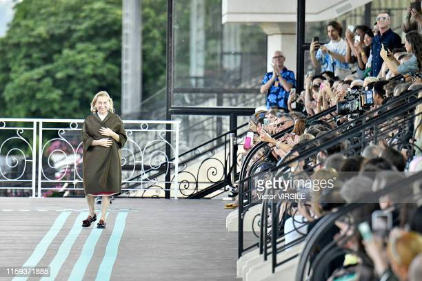 Fashion designer Miuccia Prada walks the runway during the MIU MIU resort Jockey Club Spring/Summer 2020 fashion show at the Hippodrome d'Auteuil on...