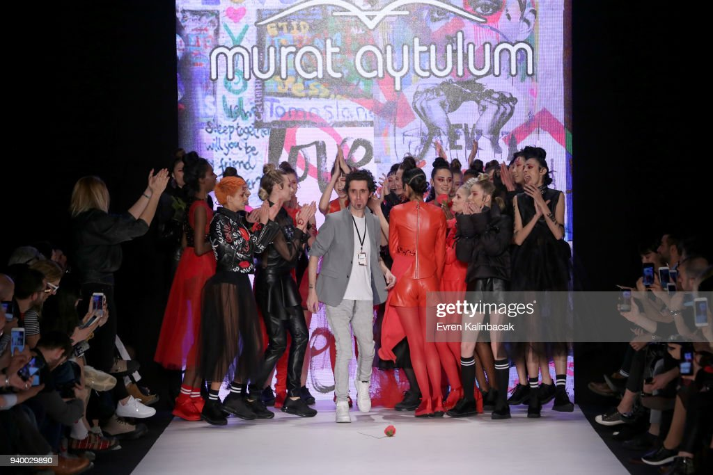 Fashion designer Murat Aytulum and Models on the runway for the Murat Aytulum show during Mercedes Benz Fashion Week Istanbul at Zorlu Performance Hall on March 30, 2018 in Istanbul, Turkey.