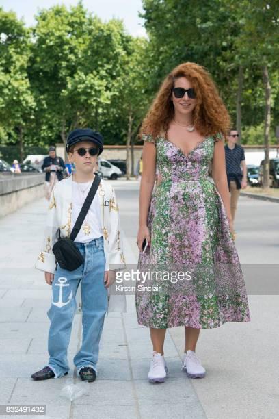 Fashion designer Natasha Zinko wears a Natasha Zinko dress and necklace Nike trainers with her son Ivan on day 2 of Paris Haute Couture Fashion Week...