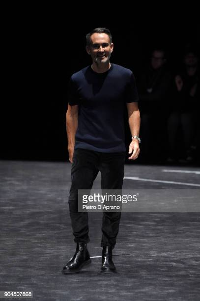 Fashion Designer Neil Barrett acknowledges the applause of the audience at his show during Milan Men's Fashion Week Fall/Winter 2018/19 on January 13...