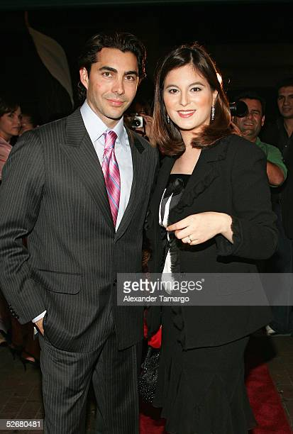 Fashion designer Nicolas Felizola and singer and actress Chabeli Iglesias arrive at the grand opening of the Nicolas Felizola store on April 21 2005...