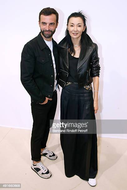 Fashion Designer Nicolas Ghesquiere and Actress Maggie Cheung pose Backstage after the Louis Vuitton show as part of the Paris Fashion Week...