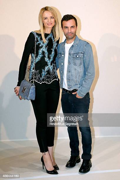 Fashion Designer Nicolas Ghesquiere and Louis Vuitton's executive vice president Delphine Arnault pose backstage after the Louis Vuitton show as part...