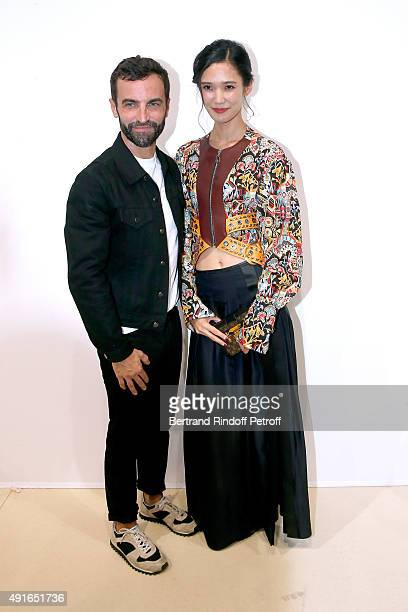 Fashion Designer Nicolas Ghesquiere and Model Tao Okamoto pose Backstage after the Louis Vuitton show as part of the Paris Fashion Week Womenswear...