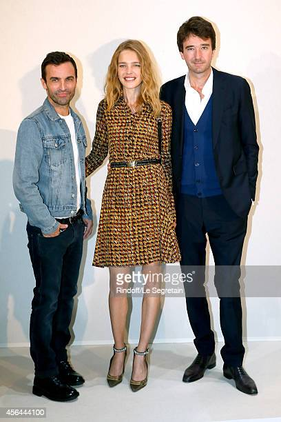 Fashion Designer Nicolas Ghesquiere Natalia Vodianova and General manager of Berluti Antoine Arnault pose backstage after the Louis Vuitton show as...