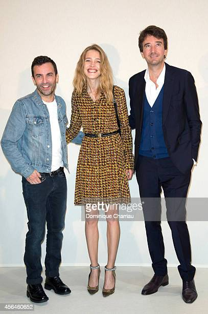 Fashion Designer Nicolas Ghesquiere Natalia Vodianova and General manager of Berluti Antoine Arnault pose backstage after the Louis Vuitton show and...