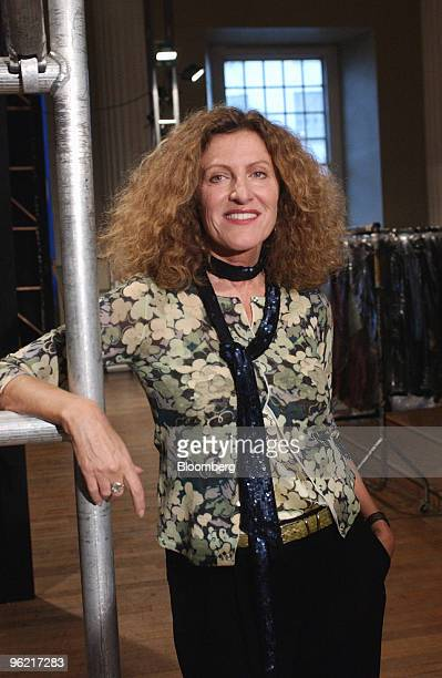 Fashion designer Nicole Farhi poses backstage after her show at London Fashion Week in central London Tuesday February 17 2004