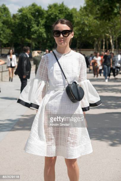 Fashion designer of clothing brand Anna K Anna Karenina wears an Anna K dress Celine sunglasses and a Marc Jacobs bag day 2 of Paris Haute Couture...