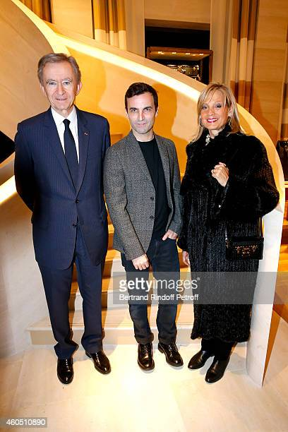 Fashion Designer of Louis Vuitton, Nicolas Ghesquiere standing between Owner of LVMH Luxury Group Bernard Arnault and his wife Helene Arnault attend...