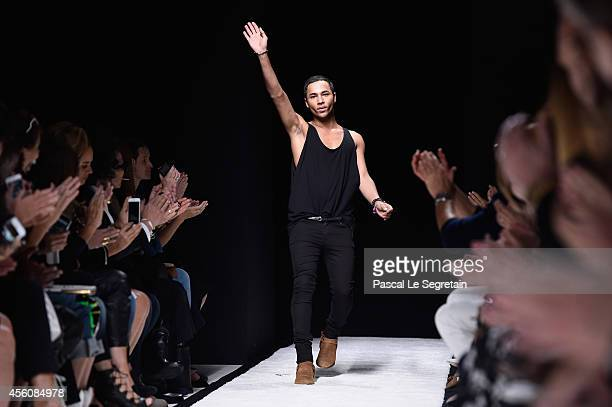 Fashion designer Olivier Rousteing acknowledges the applause of the public after the Balmain show as part of the Paris Fashion Week Womenswear...