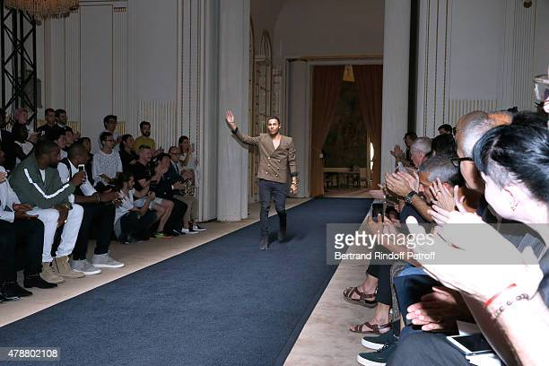 Fashion Designer Olivier Rousteing acknowledges the applause of the audience at the end of the Balmain Menswear Spring/Summer 2016 show as part of...