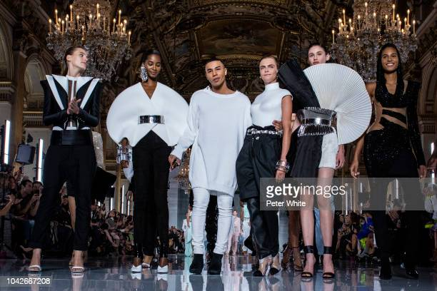 Fashion designer Olivier Rousteing and model Cara Delevingne walk the runway during the Balmain show as part of the Paris Fashion Week Womenswear...