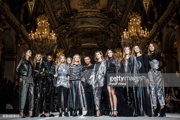 Fashion designer Olivier Rousteing and models walk the runway after the Balmain show as part of the Paris Fashion Week Womenswear Fall/Winter...