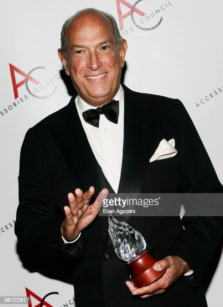 Fashion designer Oscar de la Renta is honored with the 'Designer of the Year' award at The Accessories Council 9th Annual ACE Awards gala at...