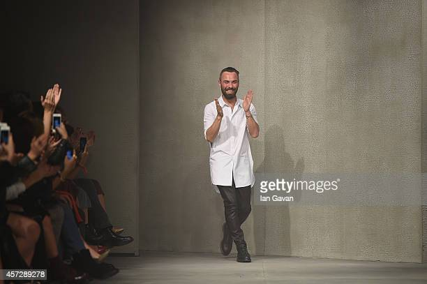 Fashion designer Ozgur Masur acknowledges the applause of the audience after the Ozgur Masur show during Mercedes Benz Fashion Week Istanbul SS15 on...