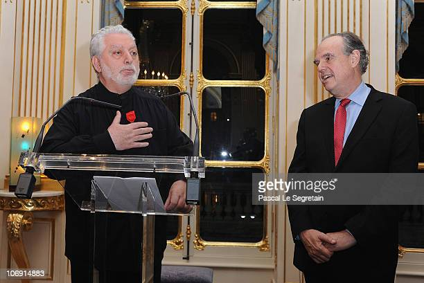 Fashion Designer Paco Rabanne delivers a speech after he received the Legion of Honor from French Culture Minister Frederic Mitterrand stands at...
