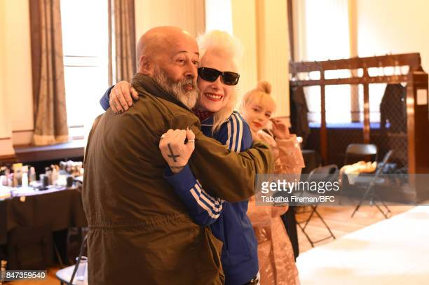 Fashion designer Pam Hogg with photographer Richard Young backstage ahead of the Pam Hogg show during London Fashion Week September 2017 on September...