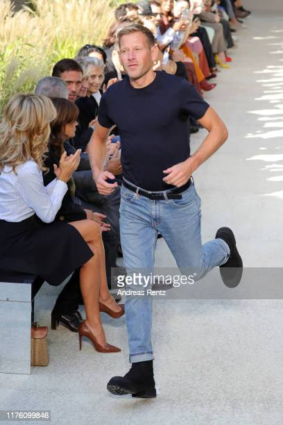 Fashion designer Paul Andrew acknowledges the applause of the audience after the runway at the Salvatore Ferragamo show during the Milan Fashion Week...