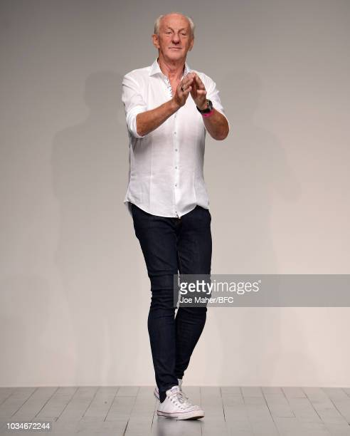 Fashion designer Paul Costelloe walks the runway at the finale of his presentation during London Fashion Week September 2018 on September 17 2018 in...