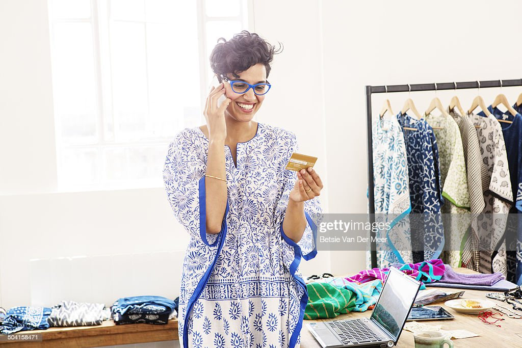 Fashion Designer Paying With Credit Card By Phone High Res Stock Photo Getty Images