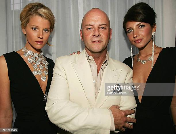 Fashion Designer Peter Morrissey poses with models at the opening of the Salone di Ruggeri on November 16 2005 in Sydney Australia