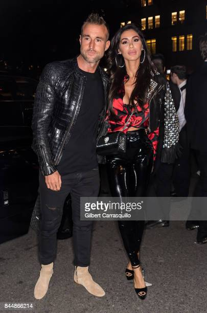 Fashion designer Philipp Plein and Andreea Sasu are seen arriving the Harper's BAZAAR Celebration of 'ICONS By Carine Roitfeld' at The Plaza Hotel...