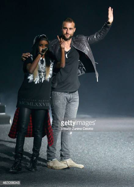 Fashion designer Philipp Plein with singer Angel Haze on the runway after his show as a part of Milan Fashion Week Menswear Autumn/Winter 2014 on...