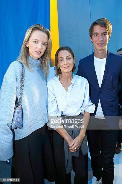 Fashion Designer Phoebe Philo standing between Alexandre Arnault and his sister Louis Vuitton's executive vice president Delphine Arnault pose after...