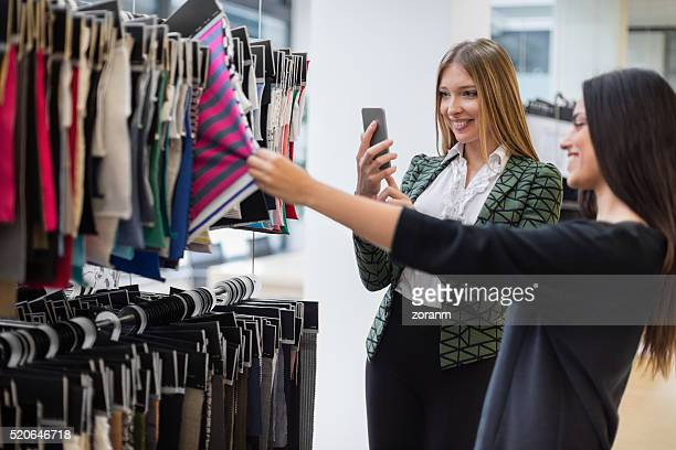 Fashion designer photographing swatches with camera phone